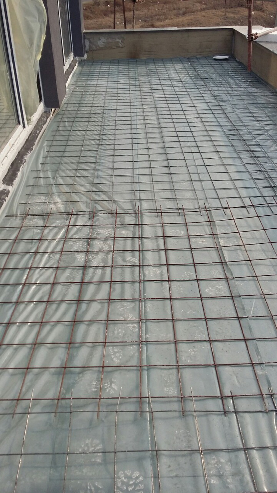 Waterproofing works and thermal insulation on a roof terrace